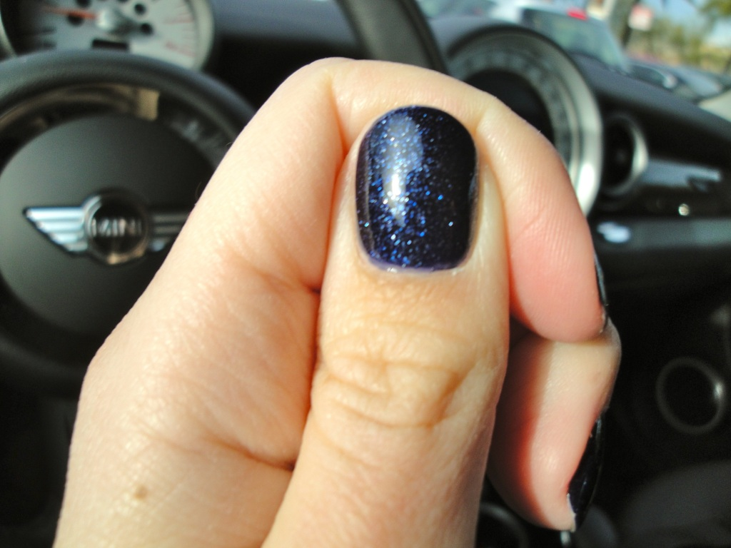 This pictures out of focus but does a blurry job of showing you the various color of pale to deep blue sparkles that the layering yields.