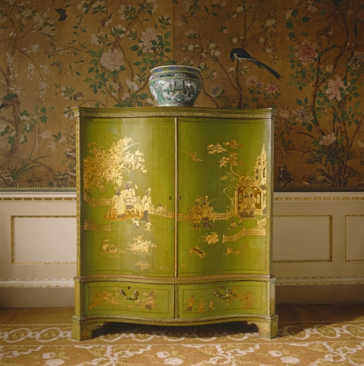 This is an eye-catching bright green cabinet painted a la chinoiserie.