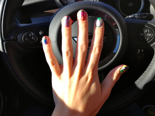 I had a lot of fun looking at this mani. I did mine a little crazy, but you could do a much more subtle look, limiting yourself to a base color and then using just one or two colors of foil for a simpler look.